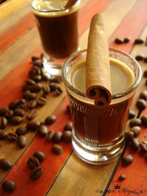 Coffee and Cinnamon Liqueur-- 150 grams of coffee - 150 ml of water - 300 g of sugar - 600 ml of boiling water - 150 ml of homemade brandy or vodka - 1 teaspoon of cinnamon In pot and pour the sugar with 150 ml water and cook for 4-5 minutes to form a syrup. Ground coffee (espresso or plain), with boiling water, let a few minutes, drain well by a double cheesecloth or a coffee filter.  Stir coffee, sugar syrup, brandy and cinnamon stick to a boil 1-2 minutes.