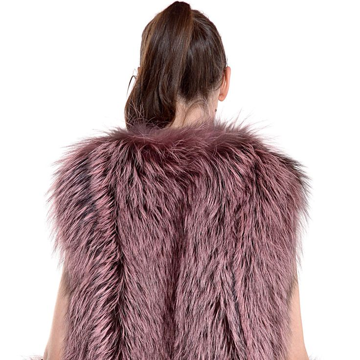 Feeling special in this edgy light purple fox fur vest.
