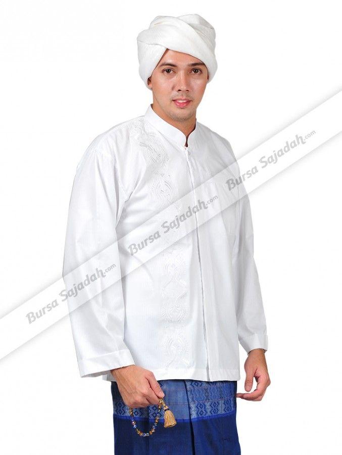 Koko Shirt Sykava, busana muslim pria dengan aneka ukuran ini didesain secara eksklusif dengan motif Islaminya yang khas & elegan. Tak hanya itu, baju koko yang mudah diserasikan dengan bawahan berwarna lain ini dibuat menggunakan bahan cotton dobby yang digemari karena lembut dan tidak gerah saat dipakai.