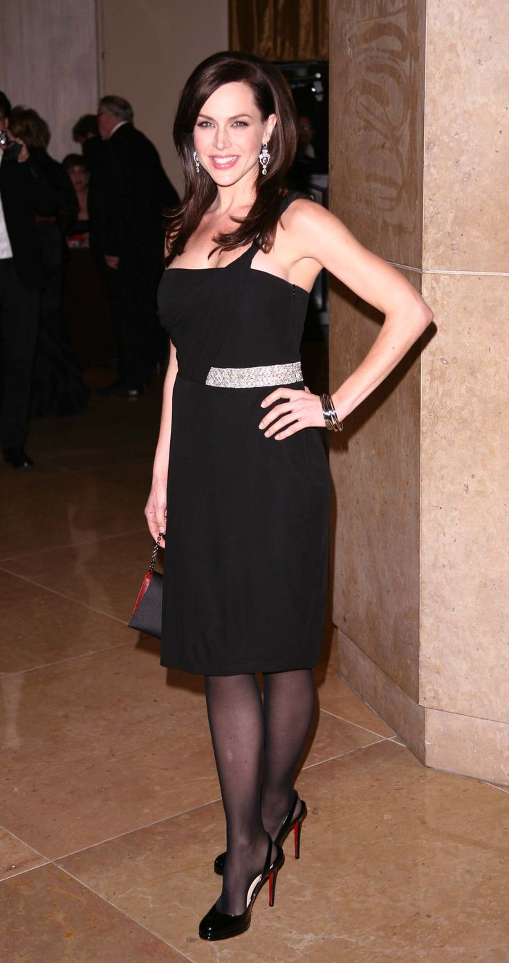 Julie Benz in black dress and pantyhose  girl in shoes