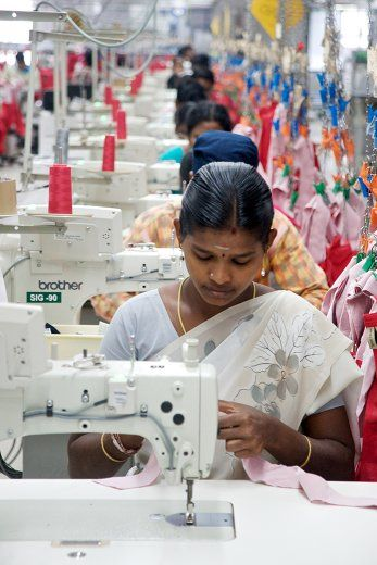 """Photo documentary """"Garment factory"""" - These images are a part of a continuing series by Shaun Fynn documenting work, workers and their environment. This factory based near Coimbatore, India, specializes in the manufacture of garments specifically for the export market and utilizes sophisticated methods of automation as well as manual labour."""