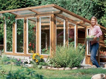 i love the looks of this with the large overhang eave and if you look close you see the greenhouse is sunk into the ground very nice solution for
