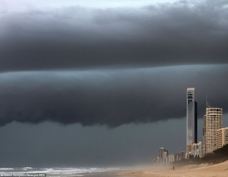 Menacing: The Gold Coast is a popular spot for sun-seeking tourists - but only the hardiest of people braved the weather on Thursday afternoon