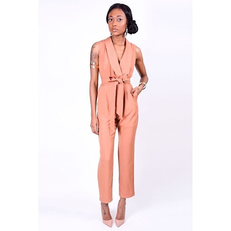 Urban Sweetheart Shelley Jumpsuit Simple, Sheek, Chic is the epitome of the Shelley Jumpsuit. Perfect transitional piece from daytime office wear (paired with a blazer) to happy hour with the girls. Color: Camel Material: Polyester  Details: Sleeveless | Criss-cross detail in front with button closure | Front-tie belt (removable) Side pockets | Partially lined