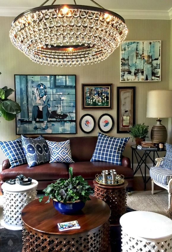 "The perfect combination of Southern traditional with modern touches define this den designed by Atlanta's own-Brian Patrick Flynn. This stylishly casual space is skillfully layered in a neutral palette of white, navy & dark brown with boldly patterned pillows. A wall of carefully curated artwork by Celery Jones provides a sense of fun & effusive""hipness."""
