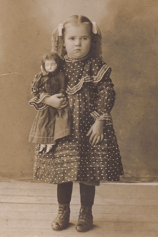 Girl with Her Doll Cabinet Card------Someone didn't want their picture taken. haha