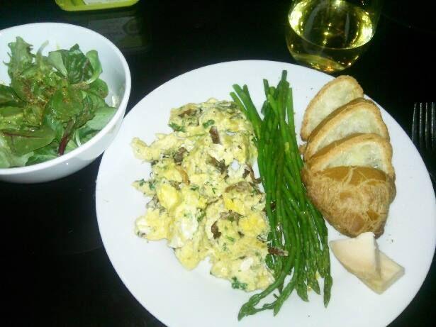 mache salad with mustard vinaigrette, creamy scrambled eggs with chanterelle mushrooms and gruyere, steamed asparagus, gluten free baguette, chardonnay
