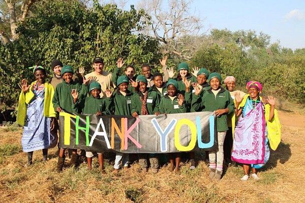 The girls, gogos, guides and volunteers say a big Thank You