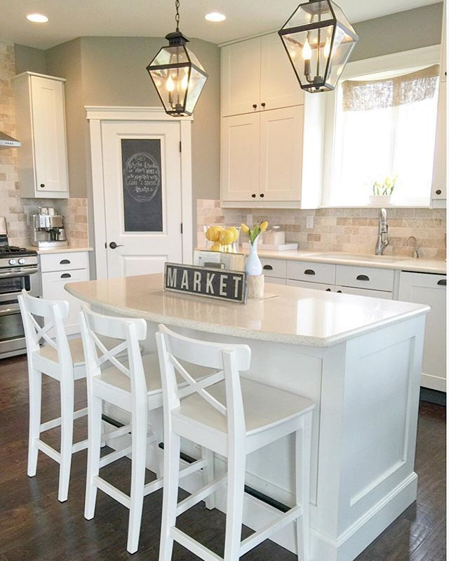 White transitional farmhouse kitchen With IKEA stools