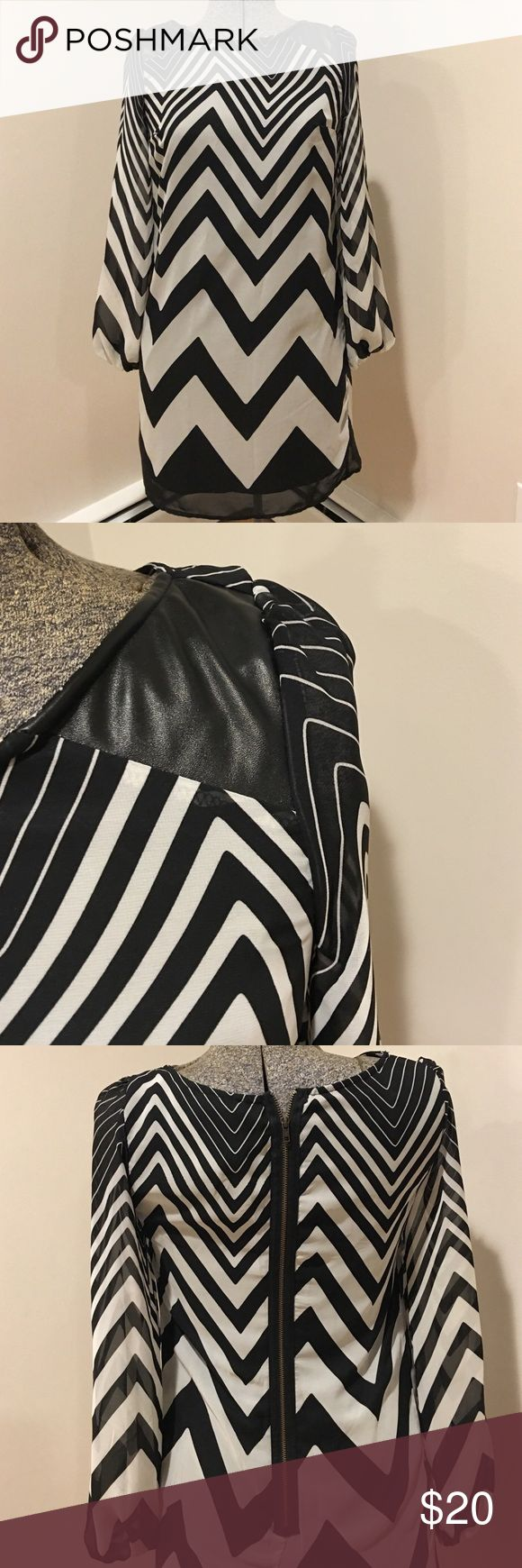 Chevron Dress Chevron Dress, black and white pattern with faux leather accents on shoulders. Zipper up back. Mid thigh length. Long sleeve (sheer). Perfect for any occasion. Dresses Long Sleeve
