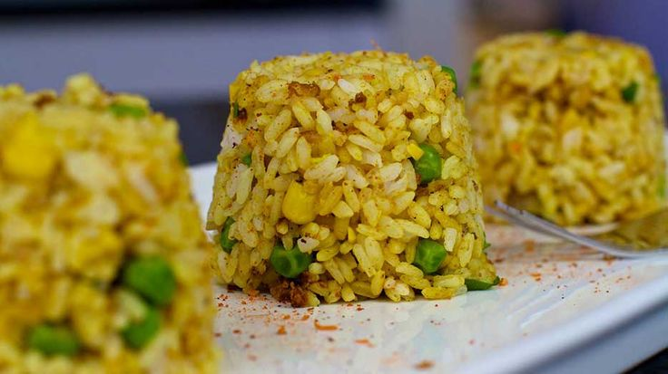 This curried fried rice recipe has no added oil or fat and is 100% plant based vegan! A great Starch Solution and McDougall friendly recipe!