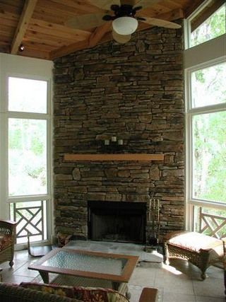 Corner fireplace stone tile accent wall our downstairs for Corner fireplace stone