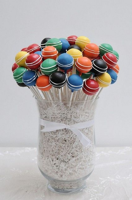 cake pop display idea- large vase and large bouquet of cake pops with shredded paper