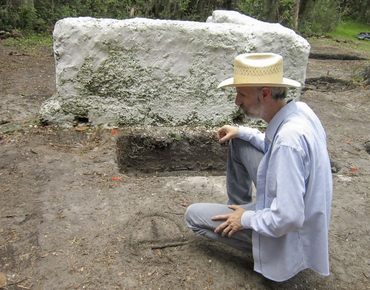 James Davidson, professor of archaeology, draws the slave cabin arrangement on the dirt in front of Cabin W-15 at the Kingsley Plantation field school in Jacksonville, Fla. The occupation of the cabin itself dates from circa 1814 to circa 1839.