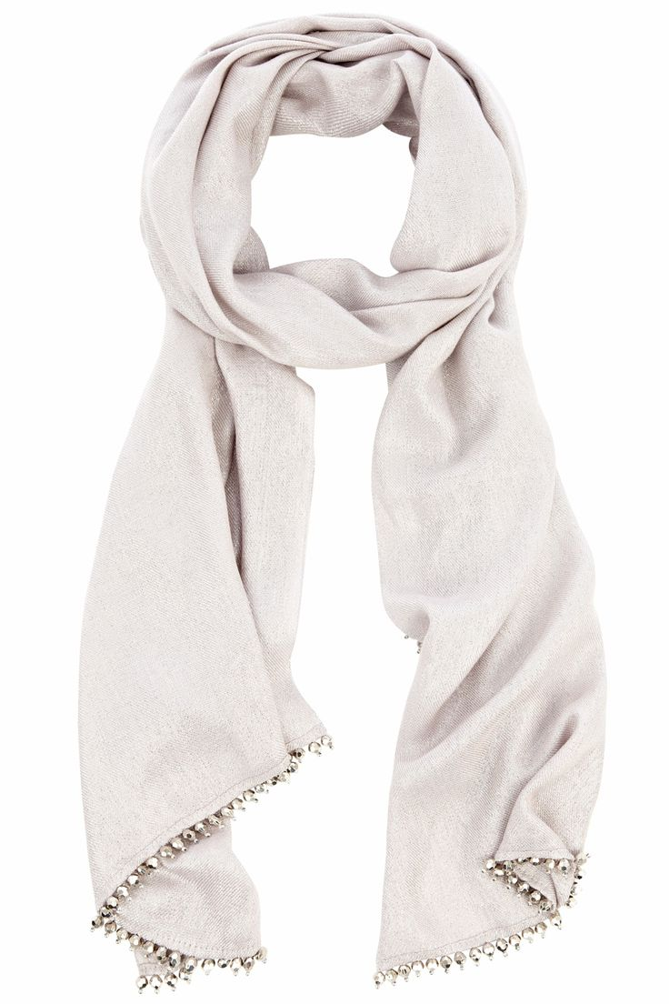 The most glamorous wrap a girl can get! The Milly Metallic wrap is a practical way to keep the chills away and remain belle of the ball. The sparkling bead trim adds a final touch of decadence.