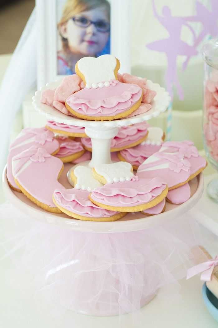 Ballerina cookies on a two-tier stand with a tutu base