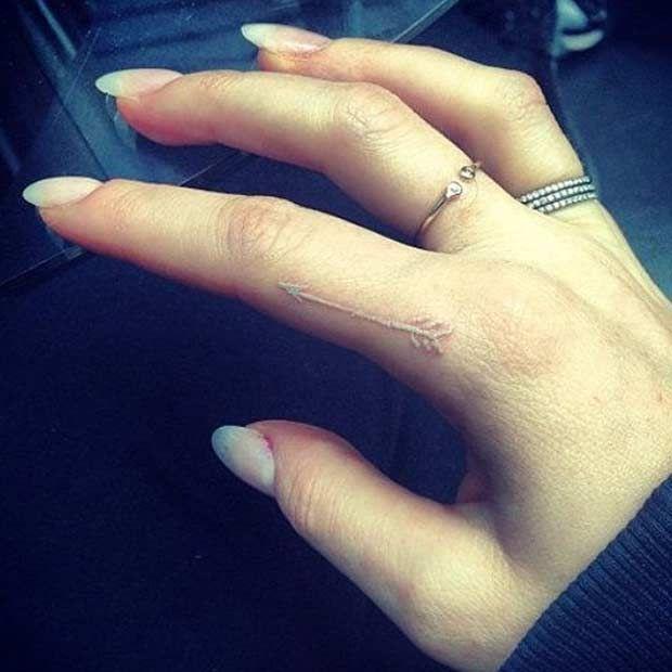 White Ink Arrow Finger Tattoo