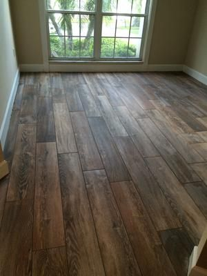 Natural Timber Cinnamon Used Mapei Chocolate unsanded grout for grout lines  faux wood tile flooring