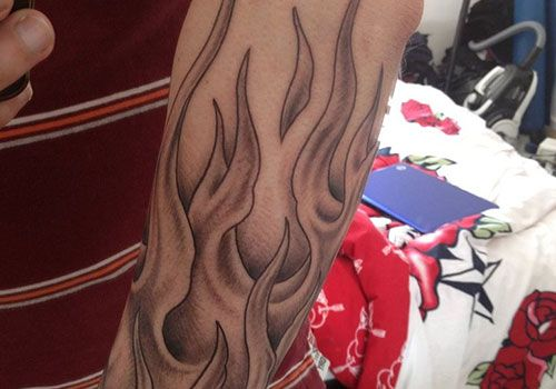 Flame Tattoo Designs on Arm Readmore http://tattoosclick.com/flame-tattoo-designs