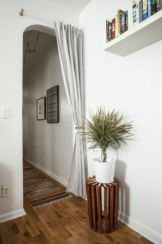 Hanging a curtain rod above a door. Doable Decorating Ideas to Steal for Your First Apartment