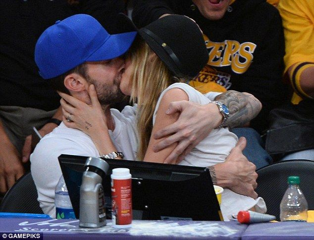 Newlywedded bliss: Adam Levine and Behati Prinsloo shared a passionate kiss at the Lakers ...