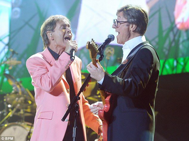 Cliff Richard and The Shadows guitarist Hank Marvin performing their 50th anniversary Concert at the NIA Birmingham