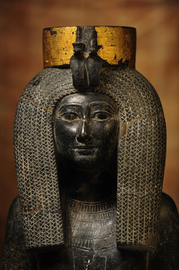 A black grantie statue of Isis, the mother of Thutmosis III
