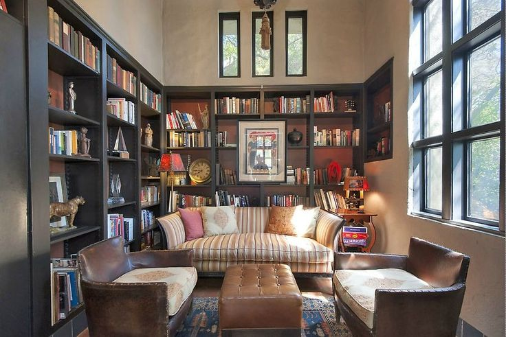 Bookcases in black plus note painting hung ON the bookcase. Like