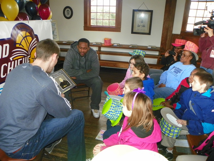 Cavs players Tyler Zeller and CJ Miles spent the afternoon with 20 students of the Louis Agassiz Elementary School to learn about President Lincoln, the history of the Little Red Schoolhouse and how they both have significant ties to Black History Month.