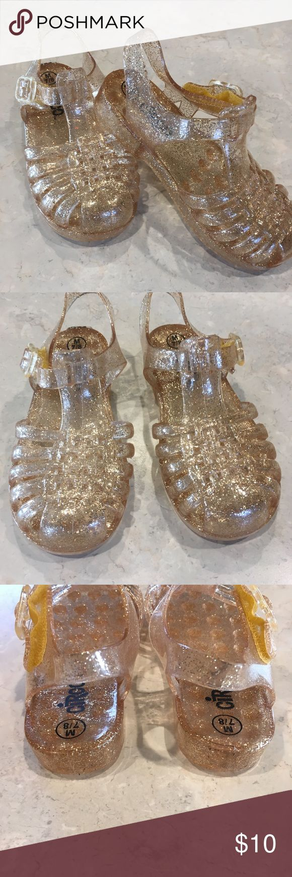 Sparkly Gold Jelly sandals.  Size 7/8 toddler Size 7/8 toddler sparkly gold jelly sandals. Some kids love jellys, mine didn't. Refused to wear even once.  I was so bummed because they are sooooo cute!  New without tags Smoke free, cat free Circo Shoes Sandals & Flip Flops