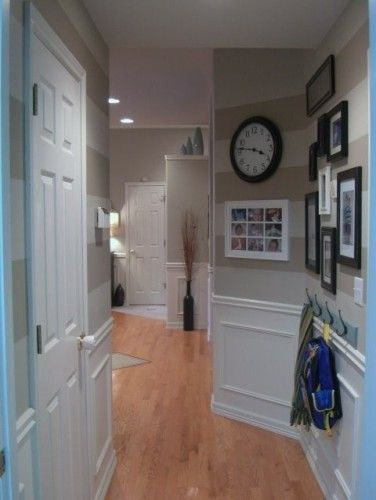 We have a really short, narrow, boring hallway between the bedrooms.  I love this striped treatment!