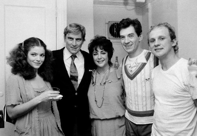 """Elizabeth Taylor, is accompanied by her husband, Sen. John Warner, R-Va., second from left, as she visits cast members of the Broadway production """"Amadeus,"""" backstage at New York City's Broadhurst Theater, July 12, 1981. Others are: Amy Irving, left; Peter Firth, right, and Ian McKellen, second from right."""