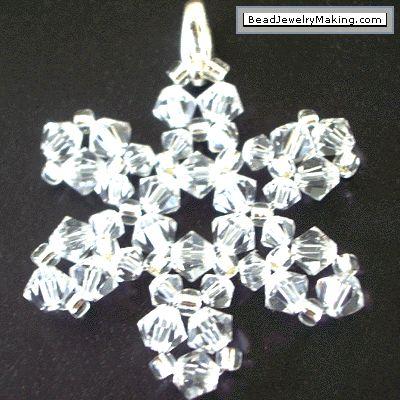 Crystal Snowflake Free online tutorial: http://www.beadjewelrymaking.com/Kid_Art_Project/Kid_art_bead_project/march2006kid_bead_project.html