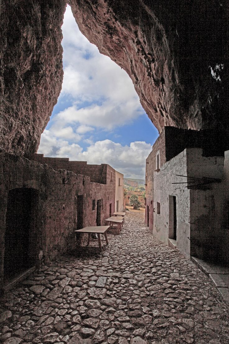 In the province of Trapani, Sicily, there's a portal through time about eighty meters high andseventy meters deep.Nestled inside the natural openi