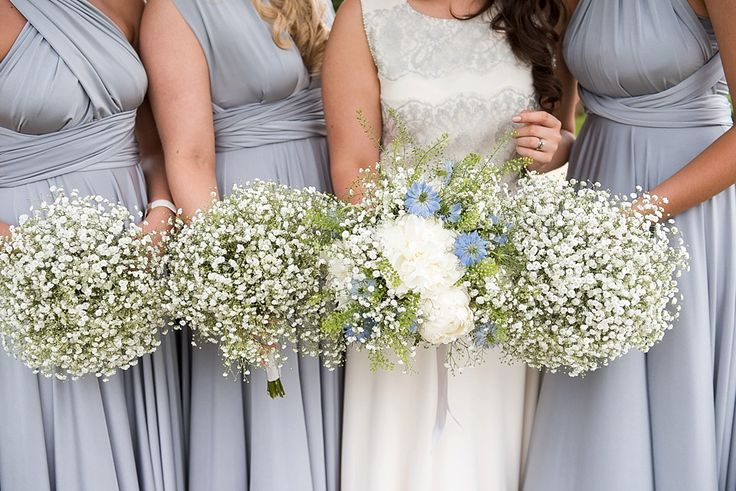 Bridesmaids wearing an elegant soft grey dress Two Birds Bridesmaid. Bride in Jenny Packham dress all holding gypsophilia bouquets at a Essex wedding © Fiona Kelly Photography