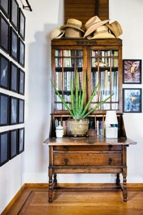 cool and carefree 1,000-square-foot san francisco apartment. An antique secretary desk contains a growing collection of vintage books.