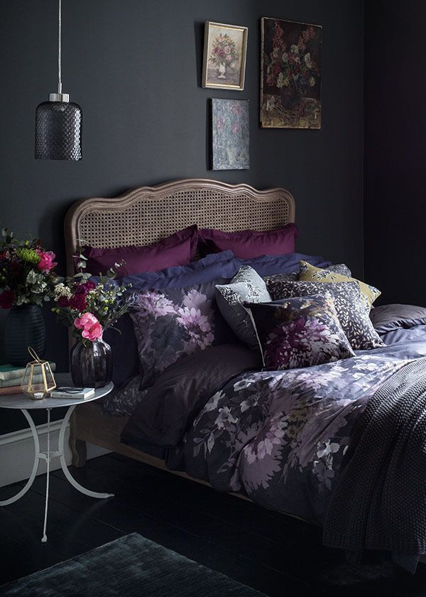Sophisticated And Dramatic Black Bedroom With Purple Accents Floral Bedroom Home Bedroom Bedroom Design