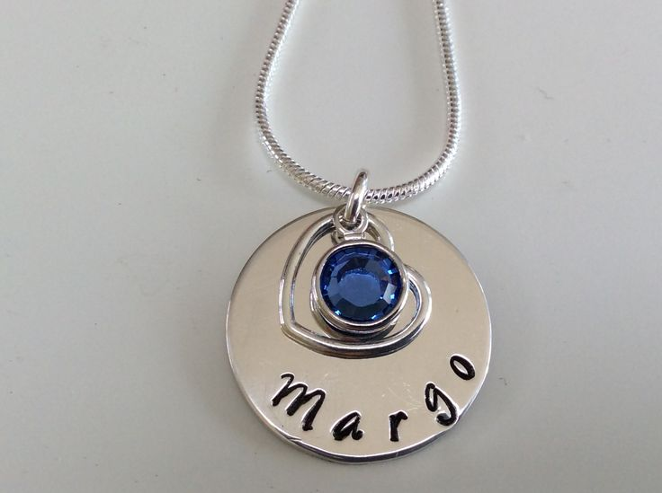 Sterling silver hand stamped disc with owners name, September Swarovski crystal (sapphire) and open heart €30