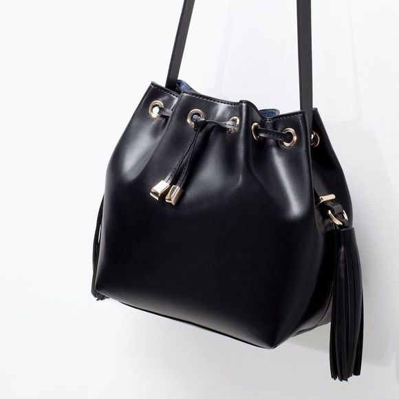 Zara Black Bucket Bag The bucket bag has been declared the bag of 2016, and this one is perfect condition. Only been worn once! No trades or comment offers please. Zara Bags Crossbody Bags