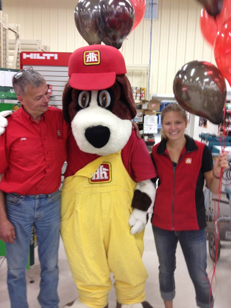 Jim Peyre ( one of the share holders) and daughter Nicole Peyre posing with Handy Home Hardwares Mascot