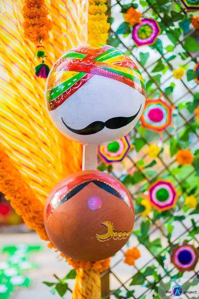 Funky mehendi decor , matkas used as props, painted matkas