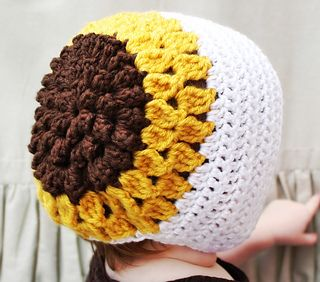 Sunflower love!  Ravelry: The Susannah Bonnet pattern by Naturally Nora