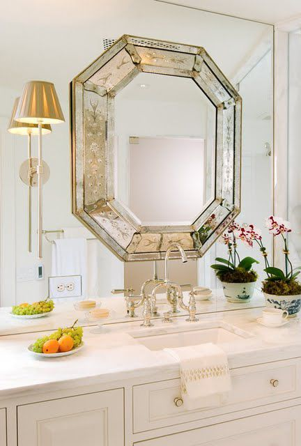MIRROR ON MIRROR, THIS IS A FAVORITE, WOULD LIKE A BATHROOM USING THIS TECHNIQUE, WITH SILVER SCONCES ON EACH SIDE AND WHITE  SUBWAY OR CARRARA MARBLE IN GLASS DOOR SHOWER.