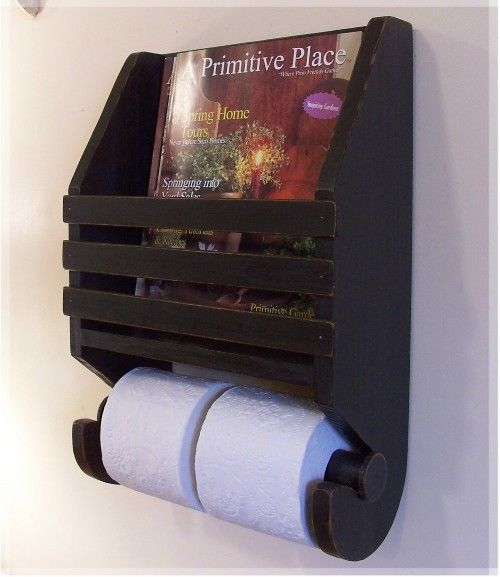Offering a Primitive Magazine and Toilet Paper rack for the Bath. Shown in Lamp Black ~ Holds several of your favorite reads and 2 rolls of tissue. A