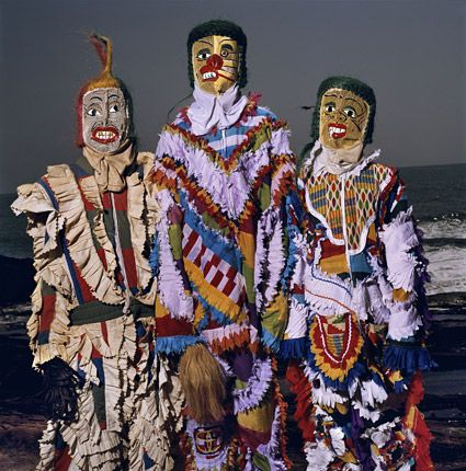 Phyllis Galembo, Three in Fancy Dress with Wire Masks, Anchors Masquerade Group, Winneba, Ghana, 2009