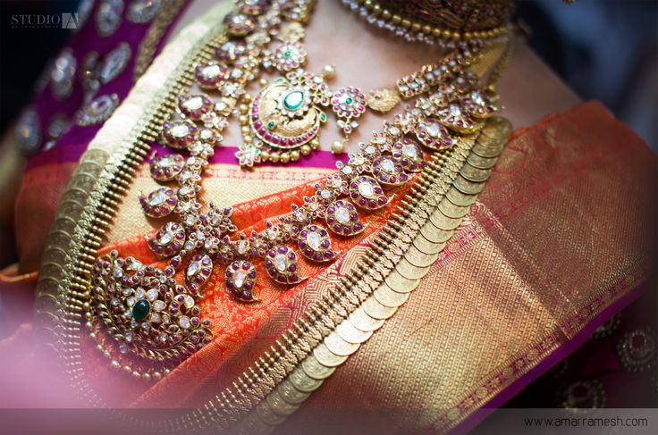 wedding weddingideas bride indianwedding wedmantra indianjewellery jewellery sareeideas orange purple silk kanchipuram saree bridalsaree brides rings bangles jhumkhas weddinginspitation goldjewellery sareedesign colourideas weddingvows weddingdress bridalwear weddingdetailshot bridalideas weddingwear weddingphotography photographyideas studioa amarramesh