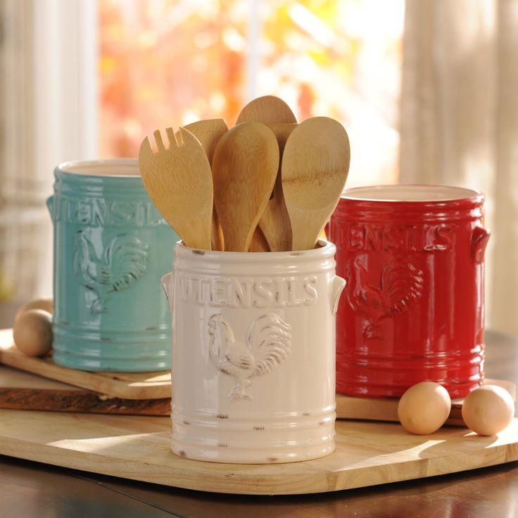 There's nothing more country than roosters and distressed colors! Keep your kitchen organized with our aqua, ivory, red, green, cobalt or white Vintage Rooster Utensil Holders.:
