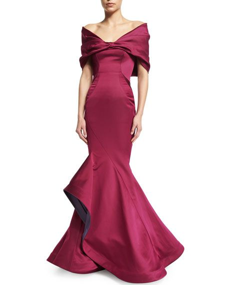 Zac Posen - Ok, Ladies, this is your big deal gown for  your biggest deal event of the Fall.  It has a Classic Fitted Mermaid Silhouette.  The top has an Off-The-Shoulder Wrap that drapes down to the elbow. The bottom flair overlaps in a petal effect, lined with Silver Gray.  I found a very complex contemporary Pink Tourmaline Necklace and Matching Earrings.  For Shoes and bag I picked up the Silver from the skirt lining. (All on this board).  You're Breathtaking! - Gabrielle