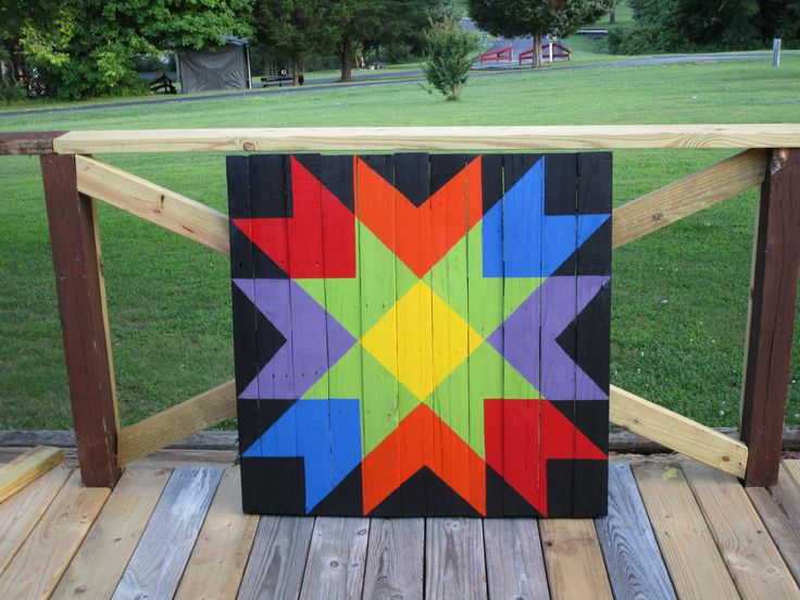 My Rainbow colored Weathervane pallet Made by BarnQuiltsbyKathy