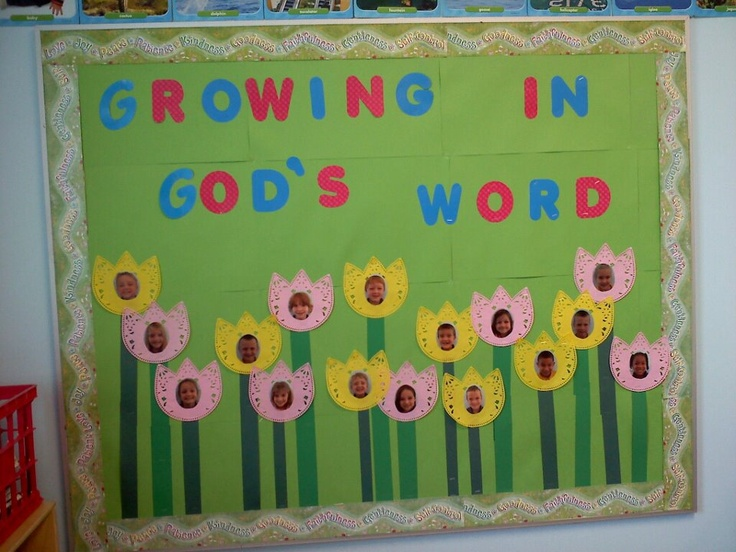 Spring bulletin board in my classroom. I put the students pics on tulip doilies. Super cute!